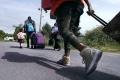 V kamióne z Rumunska odhalili 42 nelegálnych migrantov z Iraku