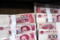 Devízové rezervy Číny klesli v januári na takmer 4-ročné minimum